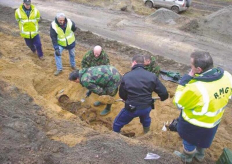 Geert Jonker and team excavating the remains of a missing German soldier found in a former slit trench, half way up an eight metre high embankment on the Arnhem-Nijmegen railway line, just south of the Rhine and east of Driel.