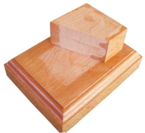 The wooden base with the block to form the ship in place.